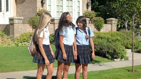 Three Pretty Uniformed Teen School Girls Standing