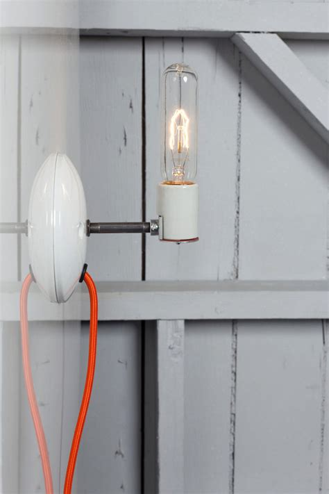 industrial wall sconce bare bulb light in