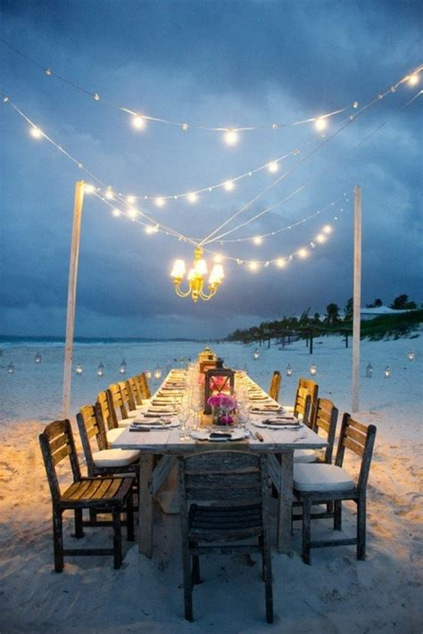 simple wedding reception table setting on the beach ideas