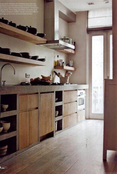 una casa en gris blanco  madera kitchens cocinas
