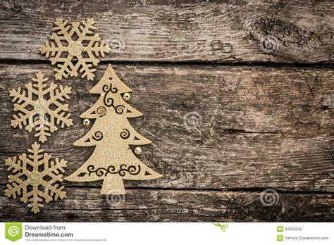 gold christmas tree decorations  grunge wood stock photo