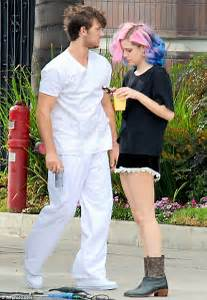 Braided lady Riley Keough reveals a diamond ring on her ...