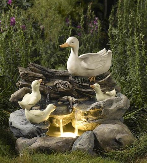 duck family  wood  rock water feature  led lights