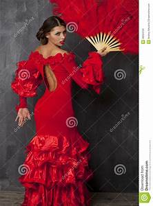 woman traditional spanish flamenco dancer dancing in a red With robe enfant flamenco
