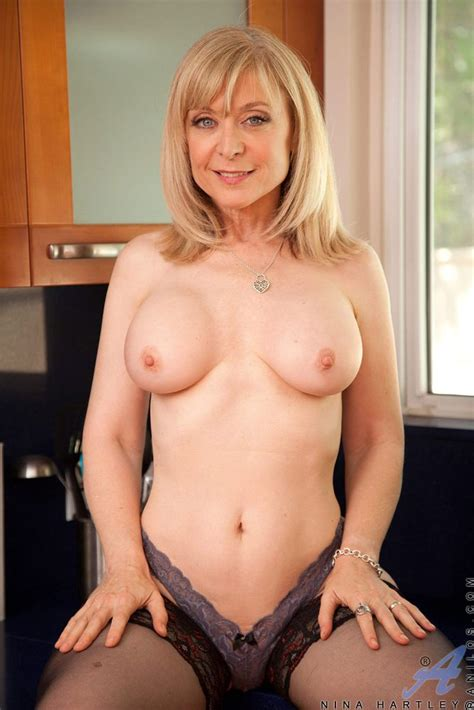 Lusty Mature Blonde Topless In Kitchen From Lustymaturemoms Com