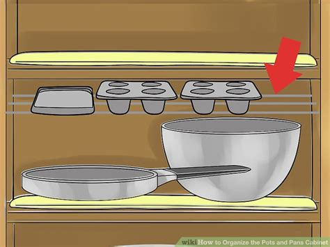 organizing pots and pans in a small kitchen how to organize the pots and pans cabinet 14 steps 9868