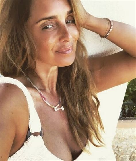 Louise Redknapp, 44, turns Baywatch pin-up in skintight ...