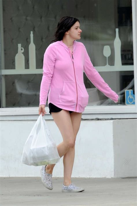ariel winter wore a pink hoodie and short shorts while ...