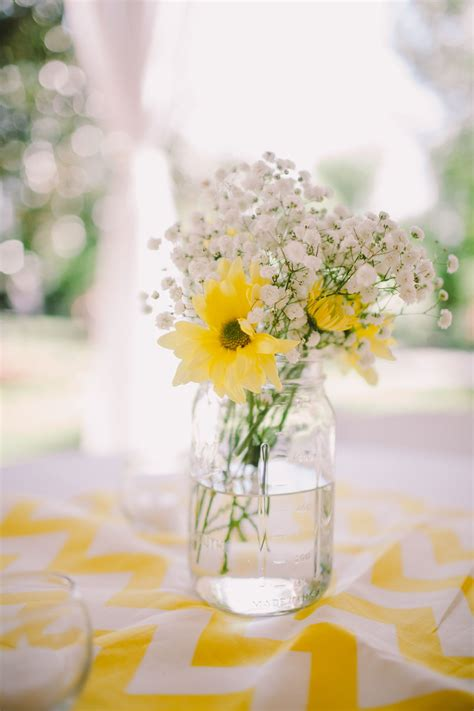 yellow daisy  babys breath centerpiece wedding
