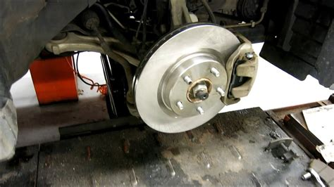 nissan quest front brake rotor removal changing