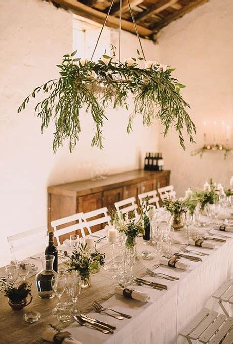 a strand of greenery hung as decoration greenery chandelier of olive branches brides