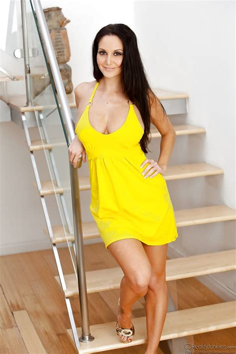 Stunner Has Nothing Against Posing In Sexy Yellow Dress
