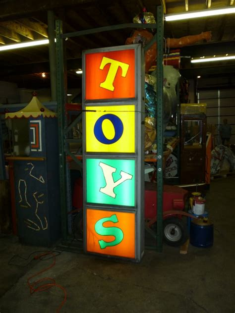 vintage toy store sign obnoxious antiques