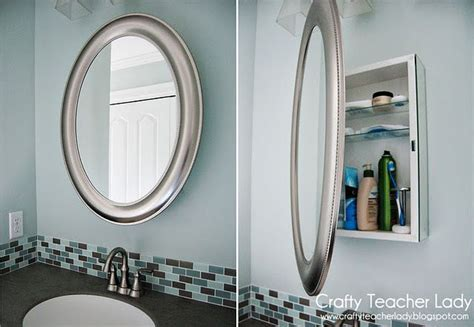 Medicine cabinet disguised as a mirror from Lowes.   Decor
