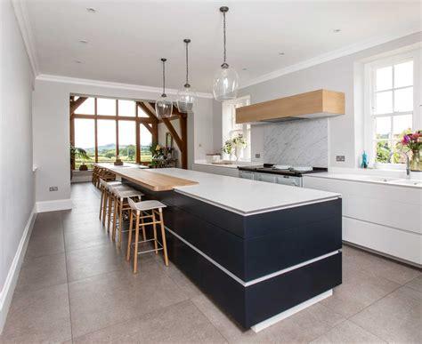open plan white modern kitchen bath bespoke