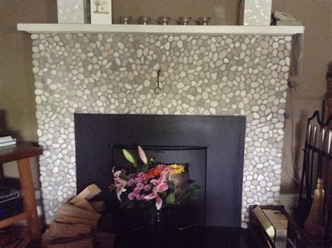 fireplace pebbles 75 best images about fireplaces pebble and tile on