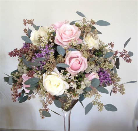 flower arrange  wine glass high level centrepiece