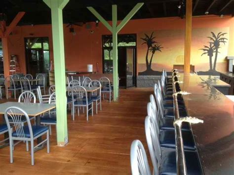 nick  jimmys bar  grill wood stained concrete