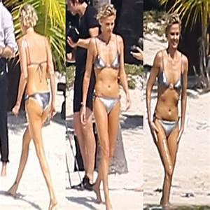 Charlize Theron showcased Four different bikinis!! Slide 3