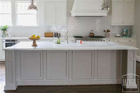 white kitchen with gray island grey center island with white marble counters 1835