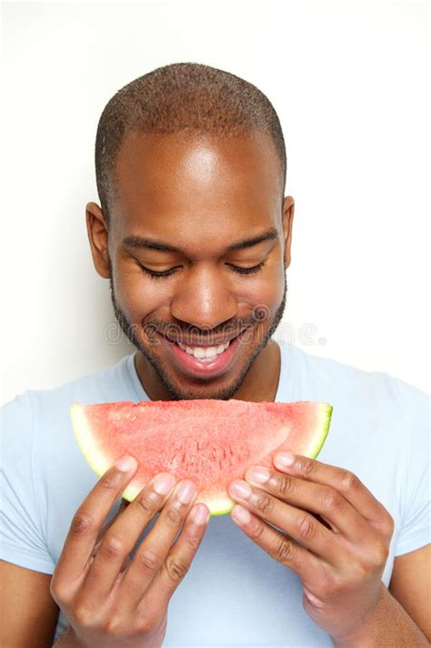 smiling man eating watermelon stock image image of