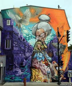 murals by a shop crew on the streets of montreal colossal