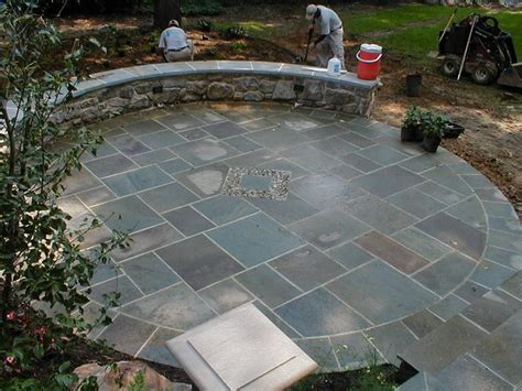 brick and flagstone patio walled flagstone patio w center accent circular border cut in blue flagstone patio ideas