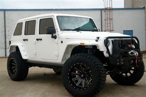 back of a jeep 2015 white jeep with slant back top pdm conversions