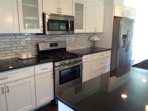 white kitchen cabinets with dark countertops dark granite countertops white cabinets home ideas