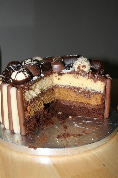 birthday cake   chocolate, coffee & vanilla sponges, sandwiched with chocolate ganache, sides