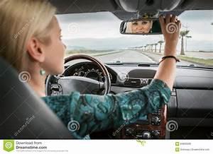 Look Auto : woman in car look in rear view mirror stock photo image of attractive automobile 64830590 ~ Gottalentnigeria.com Avis de Voitures