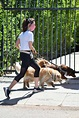 aubrey plaza sports a white top and black leggings while ...