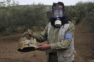 Dozens killed in suspected gas attack on Syrian rebel area ...