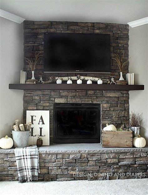 decorating fireplace mantel with tv above neutral fall mantel whiteaker