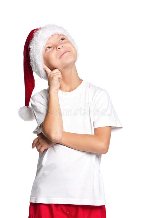 portrait  thoughtful boy  santa hat isolated  red