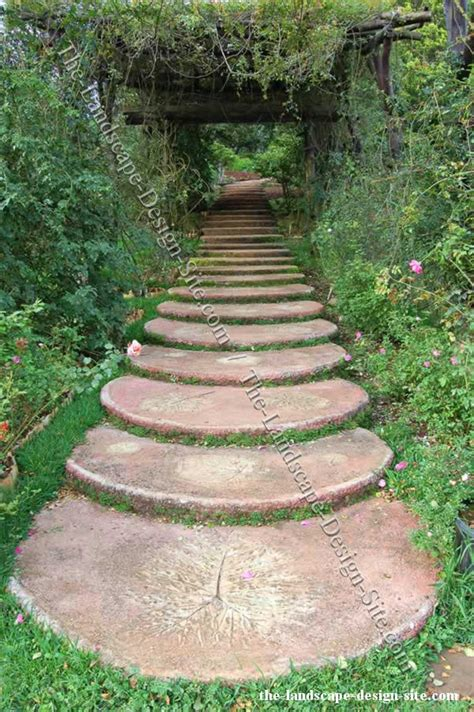 garden paths and walkways love the idea of using cuts of a tree trunk glazing them w concrete making steps for the