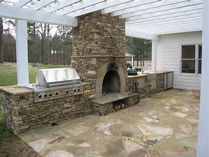 outdoor kitchens stone bbq design davel construction With outdoor kitchen and fireplace designs