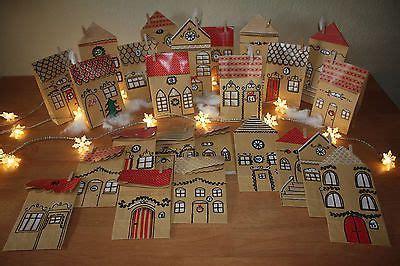 adventskalender dorf haeuser stadt handarbeit aus papiertueten zu befuehlen advent calendar