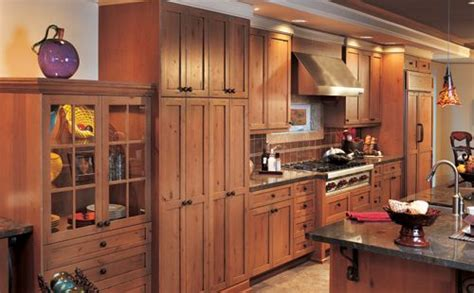 shaker crown molding pink birch alder cabinets with distressed rustic alder cabinets lend a rustic flair to a