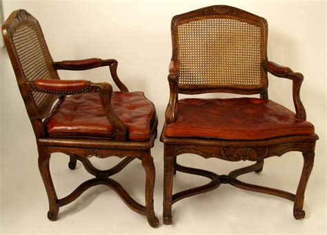 Pair Of French Regence Walnut Fauteuils Armchairs For Sale