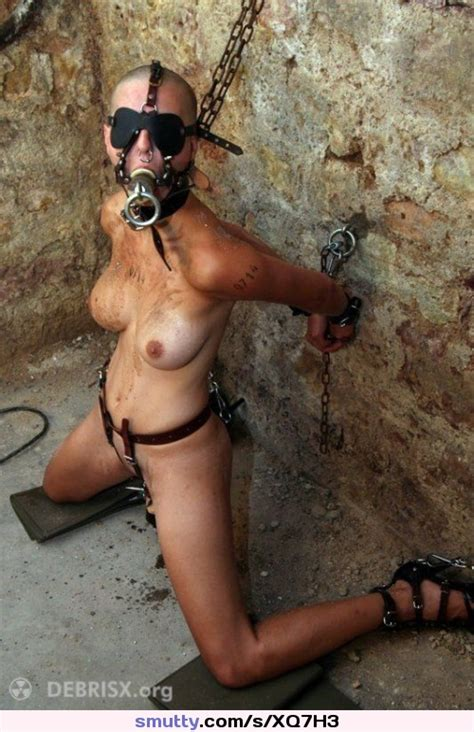 shavedhead slave restrained submissive dungeon slut chained kneeling blindfold gagged nosering