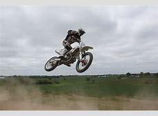 Rider Riding Green Motocross Dirt Bike · Free Stock Photo