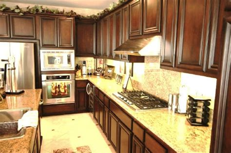 brown mahogany with mocha glaze cabinets with new venetian