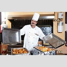 Arab Chef With Food At Restaurant Hotel Stock Photos