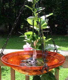 water fountain i made from an old watering can and wash