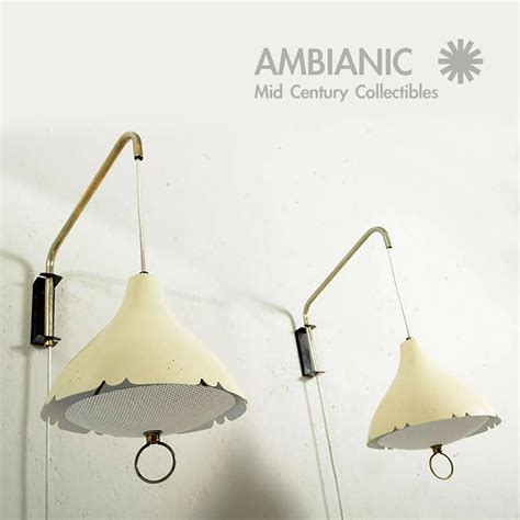 mid century modern pair of wall sconces after lightolier