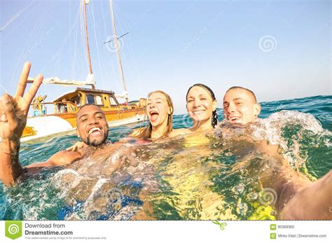 Young Multiracial Friends Taking Selfie And Swimming On