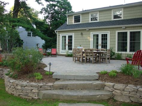 25 best raised patio ideas on retaining wall