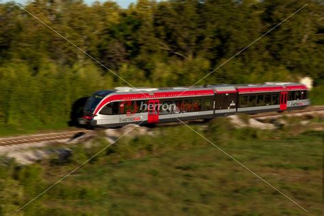 Motion Blur MetroRail Train speeds through North Austin ...