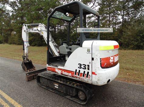 bobcat   compact mini excavator digging bucket